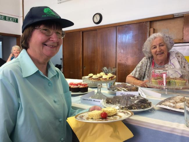 Penny Sweet is served by Cllr Mattie Ross at Bloomers Cafe, Stonehouse Town Hall