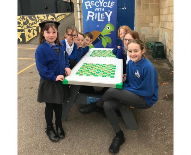 Children at Thrupp Primary School with their new table