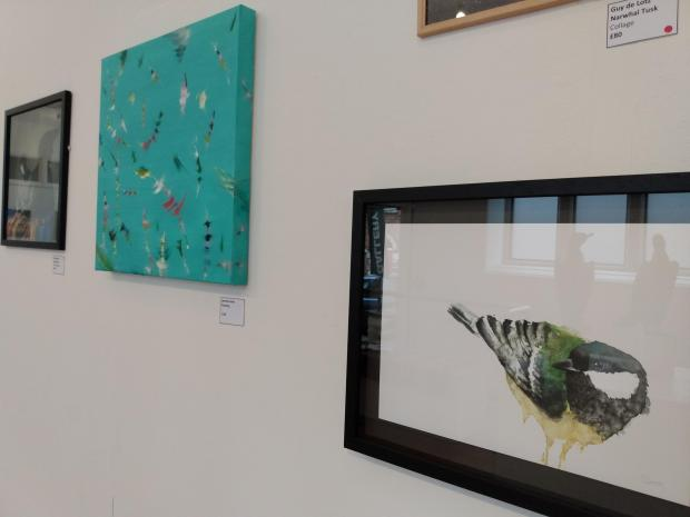 Stroud News and Journal: Stephen Baxter's great tit watercolour in the foreground