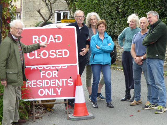 Woodchester Parish Council chairman Dr Gervase Hamilton with residents concerned about the two road closures