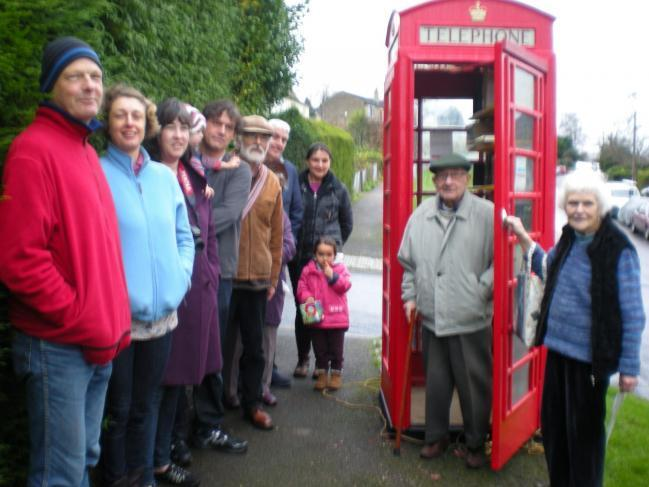 The launch party in 2016 for the Summer Street community library which is housed in a traditional telephone kiosk.