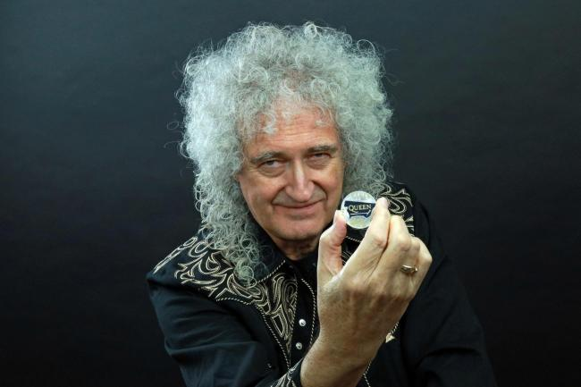 Queen guitarist Brian May with the Queen 2020 UK £5 brilliant uncirculated coin