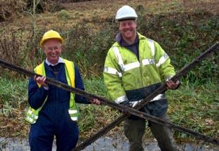 Dr Ray Wilson, honorary secretary of the Gloucestershire Society for Industrial Archaeology, and workman Matt Tewkesbury with the rails discovered under the canal towpath at Thrupp