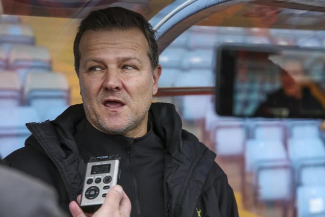 Forest Green Rovers head coach, Mark Cooper being interviewed during the EFL Sky Bet League 2 match between Scunthorpe United and Forest Green Rovers at Glanford Park, Scunthorpe, England on 22 February 2020.
