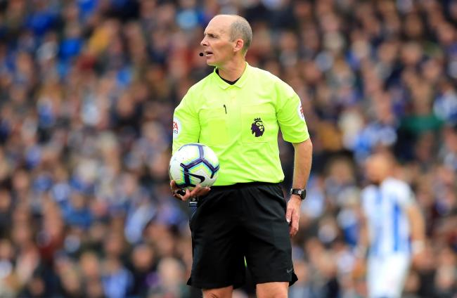 Referee Mike Dean during the Premier League match at the AMEX Stadium, Brighton.
