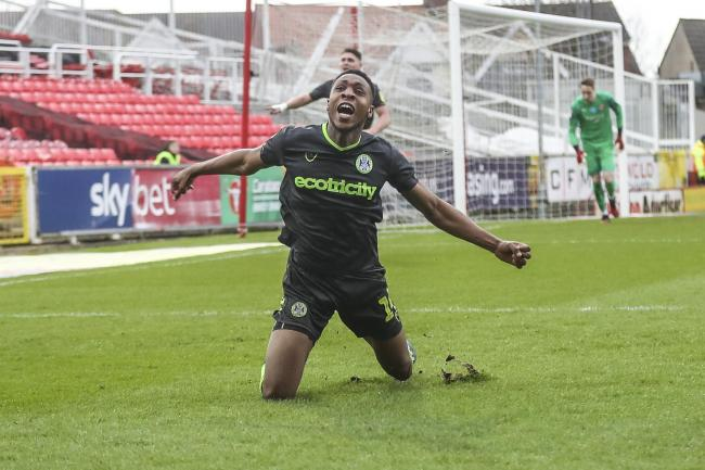 Ebou Adams celebrates  his winner at Swindon Town                                 Pic: Shane Healey
