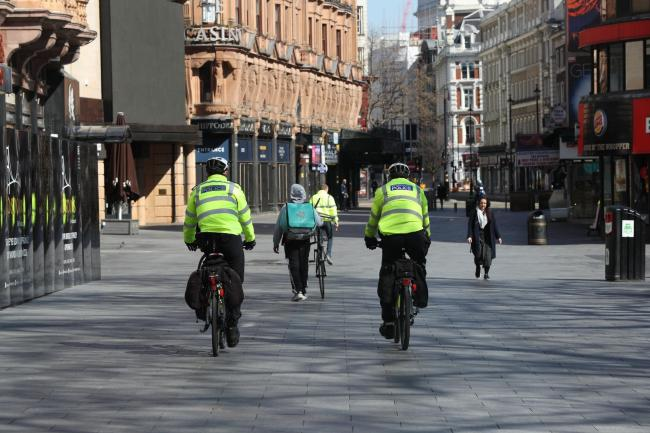 Metropolitan Police patrolling on bicycles in Leicester Square, London
