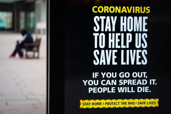 WARNING: A coronavirus awareness sign on a bus stop. Picture: PA Wire/PA Images