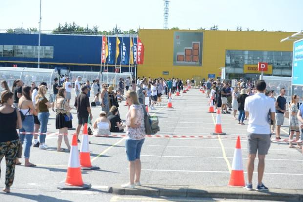 Stroud News and Journal: Customers queued two metres apart to get inside Ikea in Lakeside, Essex. Picture: Nick Ansell/PA Wire