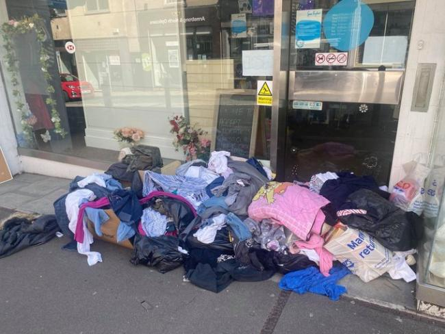 Donations left outside charity shop on George Street, Stroud. Photo by Maria Mann