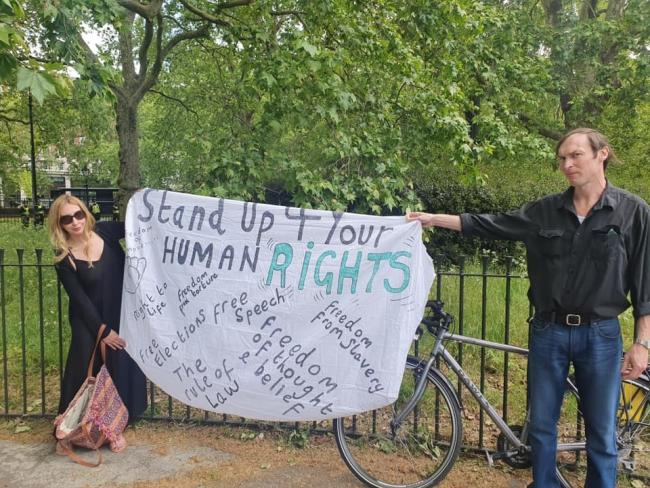 Debbie Hicks and a fellow campaigner at a protest against the coronavirus lockdown in Hyde Park, London