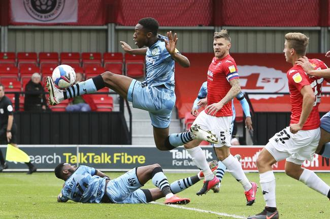 Ebou Adams drives forward against Salford City this afternoon