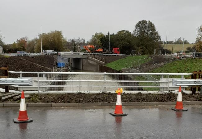 Water fills up the new section at Whitminster roundabout. Photo: Mike Gallagher