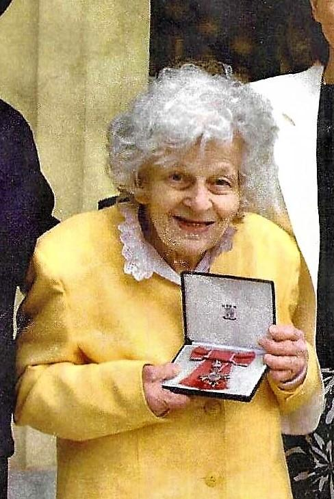 Marjorie receiving her MBE