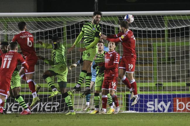 Forest Green Rovers Daniel Sweeney(4) heads the ball clear during the EFL Sky Bet League 2 match between Forest Green Rovers and Crawley Town at the New Lawn, Forest Green, United Kingdom on 29 December 2020.
