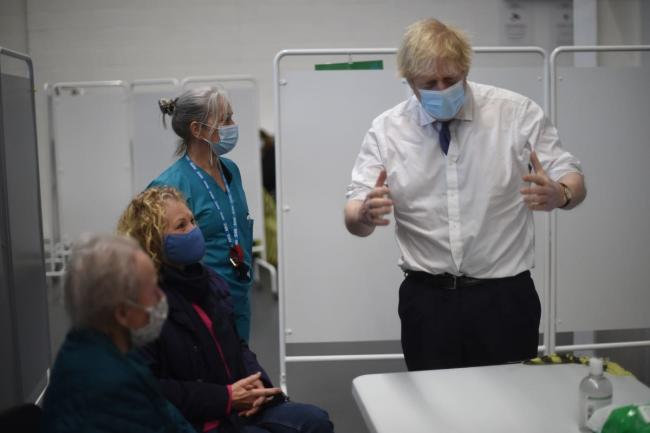 Prime Minister Boris Johnson at Ashton Gate Stadium in Bristol, during a visit to one of the seven mass vaccination centres now opened to the general public as the government continues to ramp up the vaccination programme against Covid-19. (Eddie Mulholla