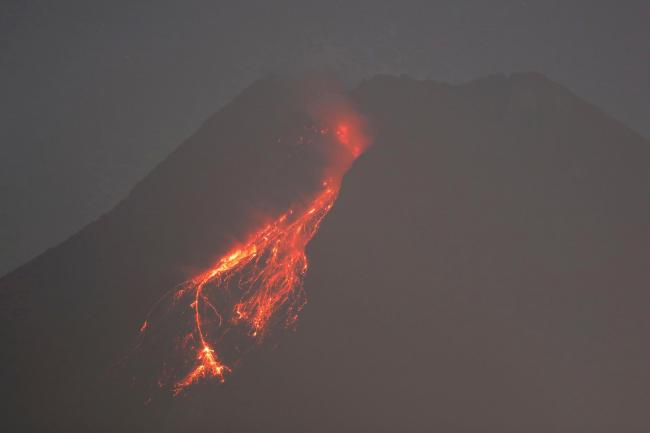 Hot lava runs down the side of Mount Merapi