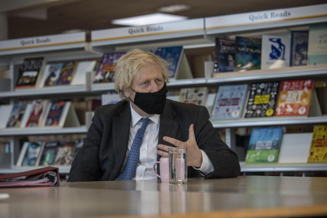 Prime Minister Boris Johnson meets with teachers in the library during a visit to Sedgehill School in Lewisham