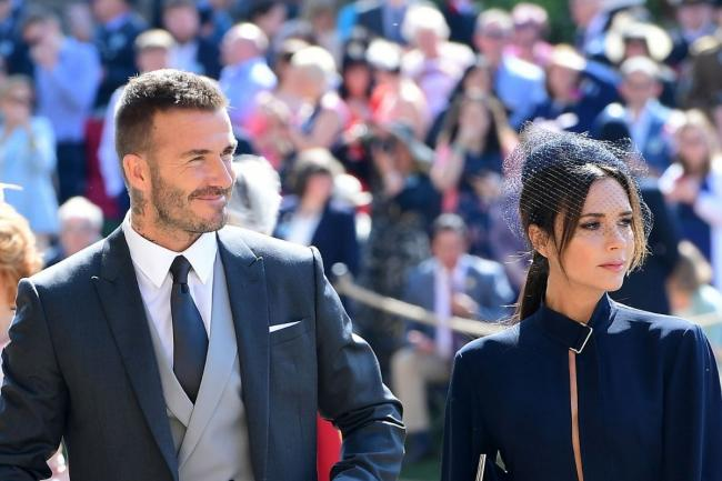 David and Victoria Beckham arrive at St George's Chapel at Windsor Castle for the wedding of Meghan Markle and Prince Harry // PA 2018