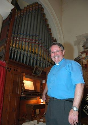 Rev Brian Woollaston beside the historic pipe organ at St Paul's Church in Whiteshill, Stroud, which is to be restored using cash donated by the Heritage Lottery Fund