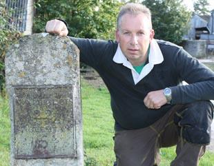 Canal volunteer Jon Pontefract with one of eight original milestone markers he has unearthed along the Thames and Severn Canal between Stroud and Inglesham, near Lechlade