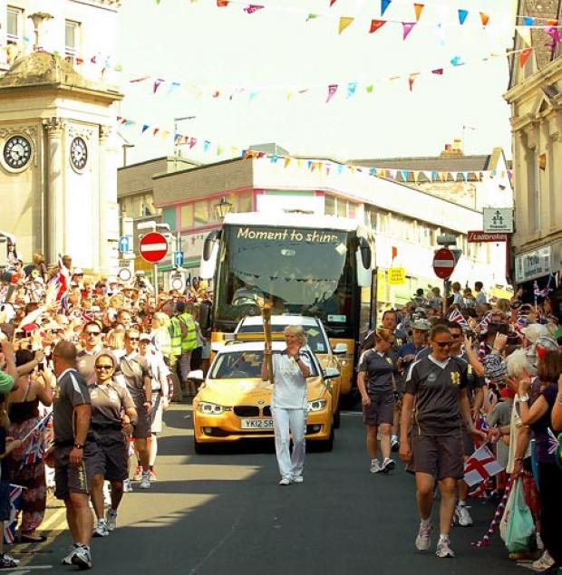 Stroud News and Journal: Large crowds pack the streets to cheer on Olympic Torchbearer Daphne Edwards.