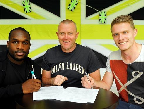 PEN TO PAPER: Kieron Forbes (left) David Hockaday and Yan Klukowski  at the New Lawn on Tuesday  Picture: Carl Hewlett
