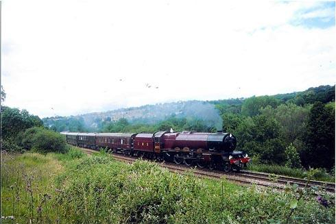Steam train carrying the Queen passes through Stroud