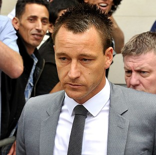 Chelsea captain John Terry leaves Westminster Magistrates' Court after he was cleared of hurling a racist insult at QPR player Anton Ferdinand