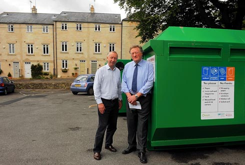 District councillor Nigel Cooper with Painswick resident Gordon Anderson at the recycling bank in the Stamages Lane car park - some residents are angry because the banks have been moved which they say causes a noise nuisance