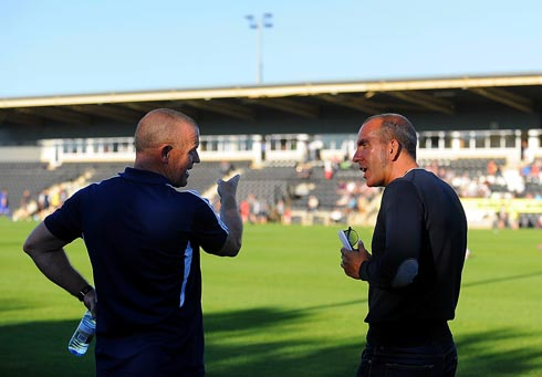 David Hockaday and Paulo Di Canio deep in convers