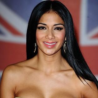Nicole Scherzinger says her relationship with Lewis Hamilton is a 'work in progress'