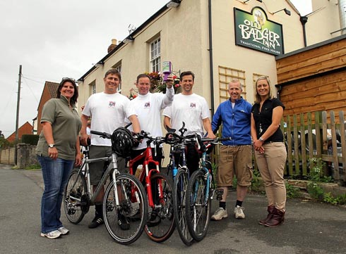 Four of the Old Boys taking part in the Cotswold Crunch cycle ride. Pictured the four riders from left Brian Channon, Andy Lazenbury, Neal Utting and Mark Rymell with landladies of the Old Badger Inn in Eastington left Ellie Sainty and right Julie Gilbors