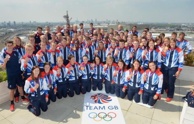 Great Britain: The Team GB Olympic medal winners - yesterday afternoon's two aside-line up for a commemorative photo at Team GB house ahead of the closing ceremony