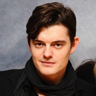 Actor Sam Riley admitted he felt like he should bow when Anglelina Jolie arrived on the set of their new film