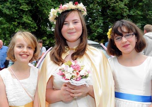 Flower queen Imogen Smith (centre) with Leonie Chambers (left) and Amber Nash, all 11, at Bisley Fete and Flower Show on Saturday