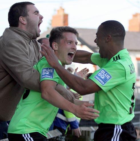 FAN-TASTIC: Stephen Brogan celebrates his late winner at Macclesfield  Picture: Shane Healey