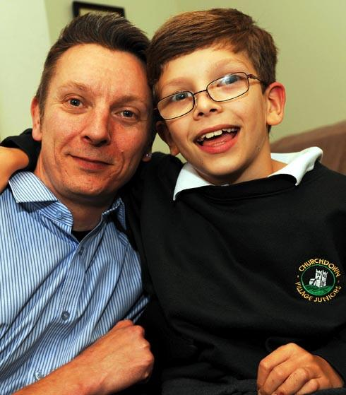 James Dwight, nine, pictured with his father Jai at home in Arlingham