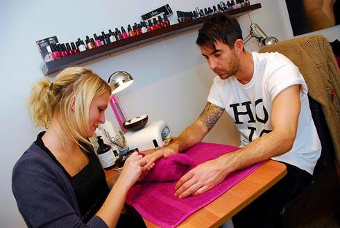 SAFE HANDS: FGR goalkeeper Sam Russell has his nails treated by beauty therapist Kaylee Hankins Pic: M. Watkins