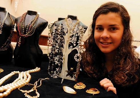 Stroud High School student Sophia Rawlinson, 15, selling jewellery at Bussage Village Hall on Saturday to raise funds for her trip to South Africa
