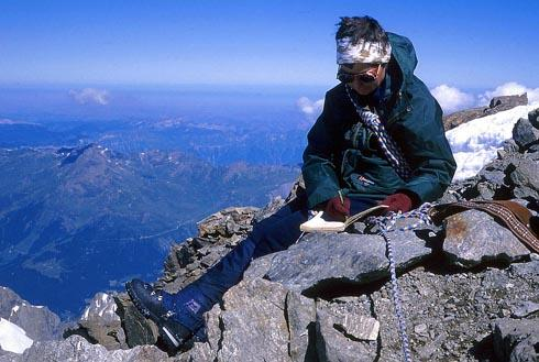 Barbara in 1990 signing the summit book at the top of the Schreckhorn - one of the 52 highest mountains in the Alps. Climbers sign the books to show they have reached the summit of a mountain