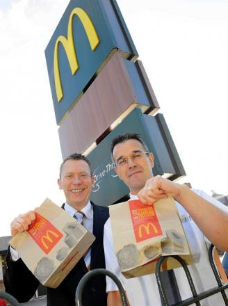 Paul Booth, McDonald's franchisee (left) has worked with the fast food chain for 30 years, pictured with Andy Newbound, restaurant manager
