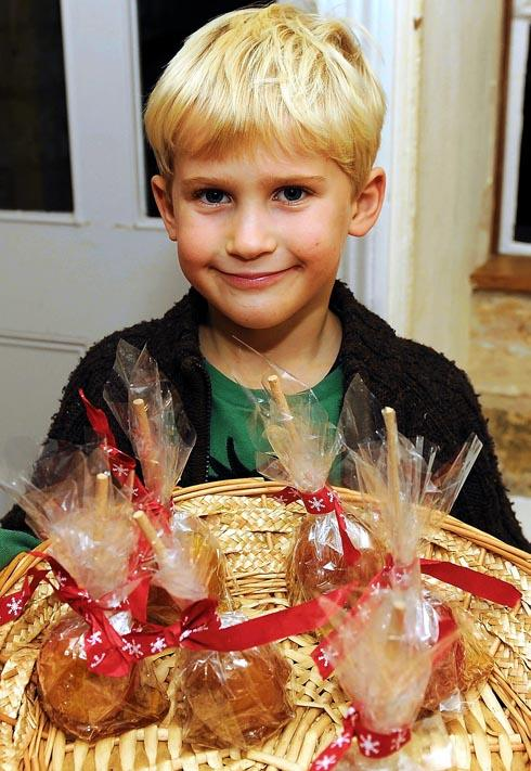 Ted Bradshaw, six, selling toffee apples at Painswick Goodwill Evening on Friday to raise money for Painswick Community Orchard