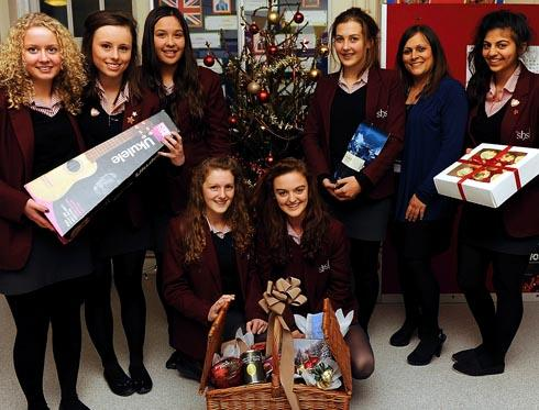 Girls at Stroud High School with some of the prizes which were donated for the charity auction which raised £3,000