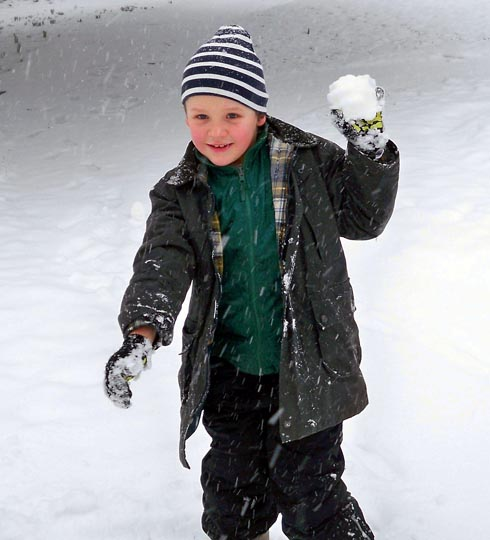 Fraser Walker-Cobbe, seven, enjoying the snow in Bank Gardens on Friday morning Picture: Ash Loveridge   SCH129V12