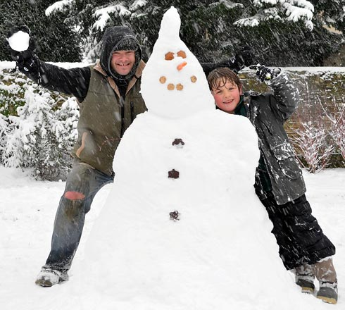 Fraser Walker-Cobbe, seven, built this snowman in Bank Gardens with his father Hector Cobbe on Friday   SJW132H13