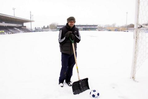Stroud News and Journal: Forest Green groundsman Stewart Ward on the snowy New Lawn pitch