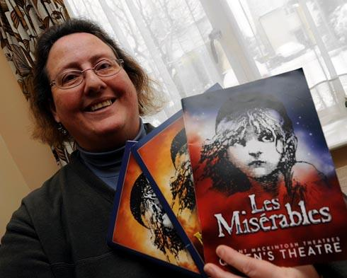 Sally Frith with some of the programmes she owns from the Les Miserables stage production which she has seen 958 times