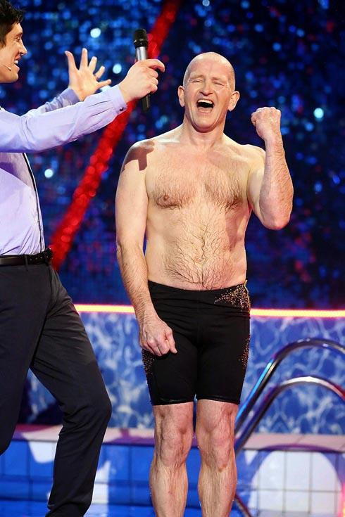 Eddie the Eagle celebrates with host Vernon Kay after scoring a perfect 30 points on ITV'S Splash!
