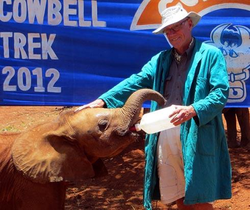 Adventurer David Lemon feeding baby elephant, Zambezi, with Cowbell milk